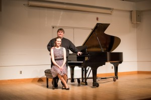 two musicians onstage with Steinway piano