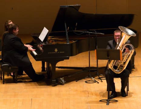 three musicians onstage with Steinway piano